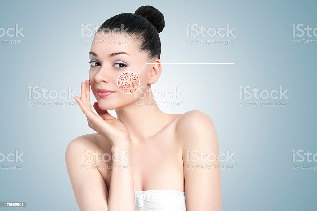 Portrait of woman with digitally enlarged pore for skin care stock photo