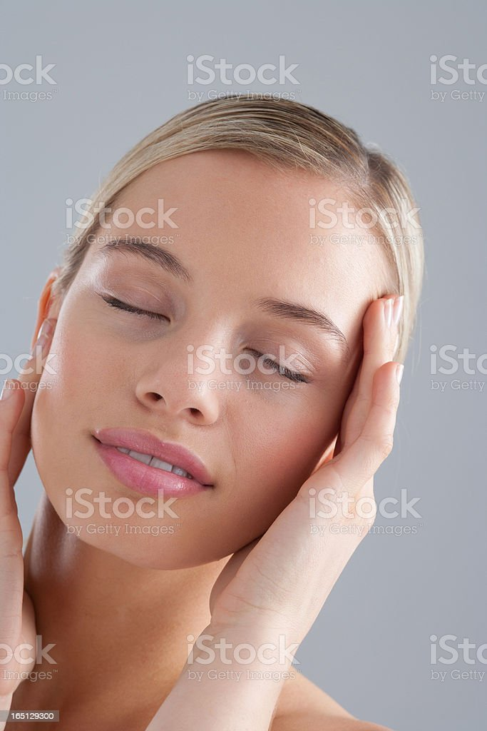 Portrait of woman with eyes closed stock photo
