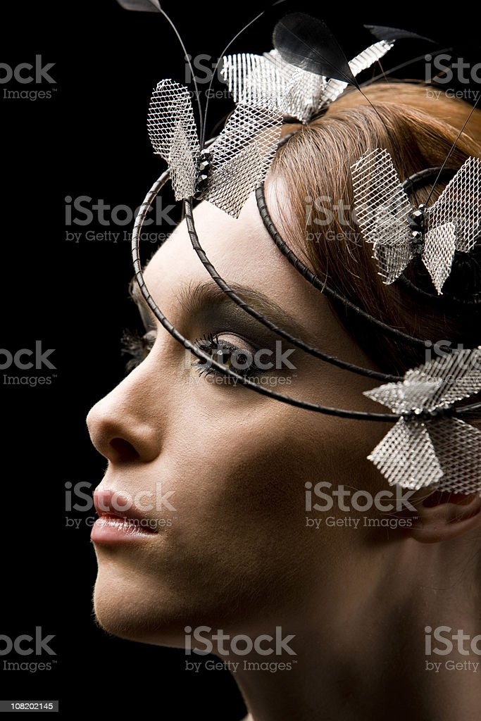 Portrait of Woman With Fancy Hat, On Black Background royalty-free stock photo