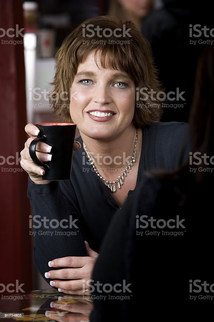 Portrait of Woman with Friend in Coffee House royalty-free stock photo