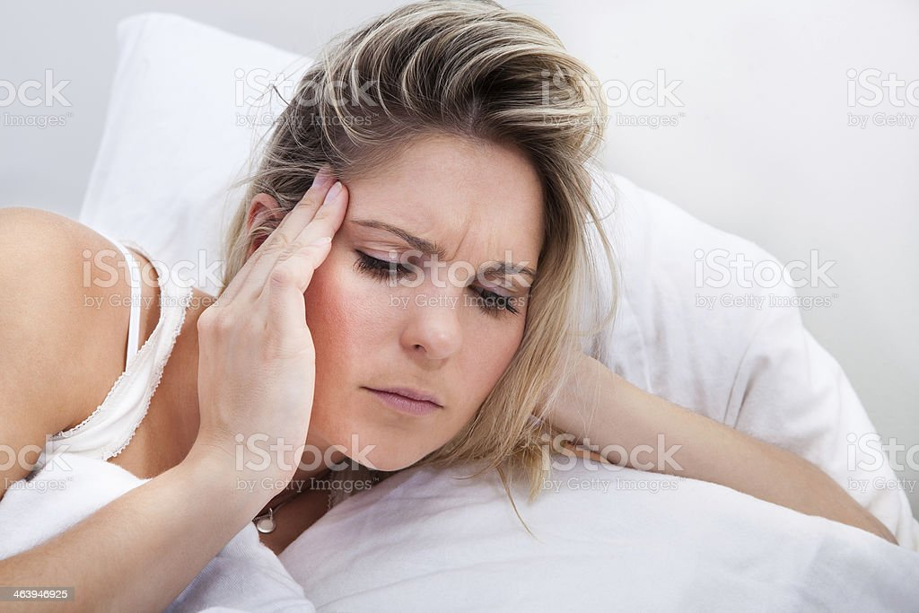 Portrait of woman with headache stock photo