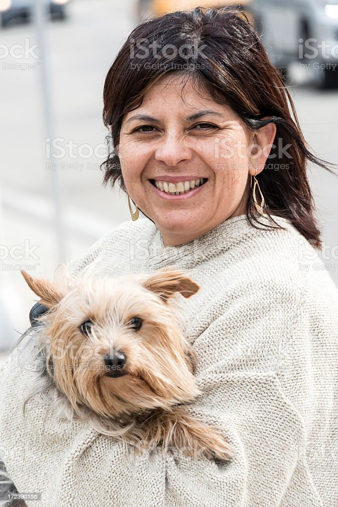 Portrait of woman with her Yorkie royalty-free stock photo