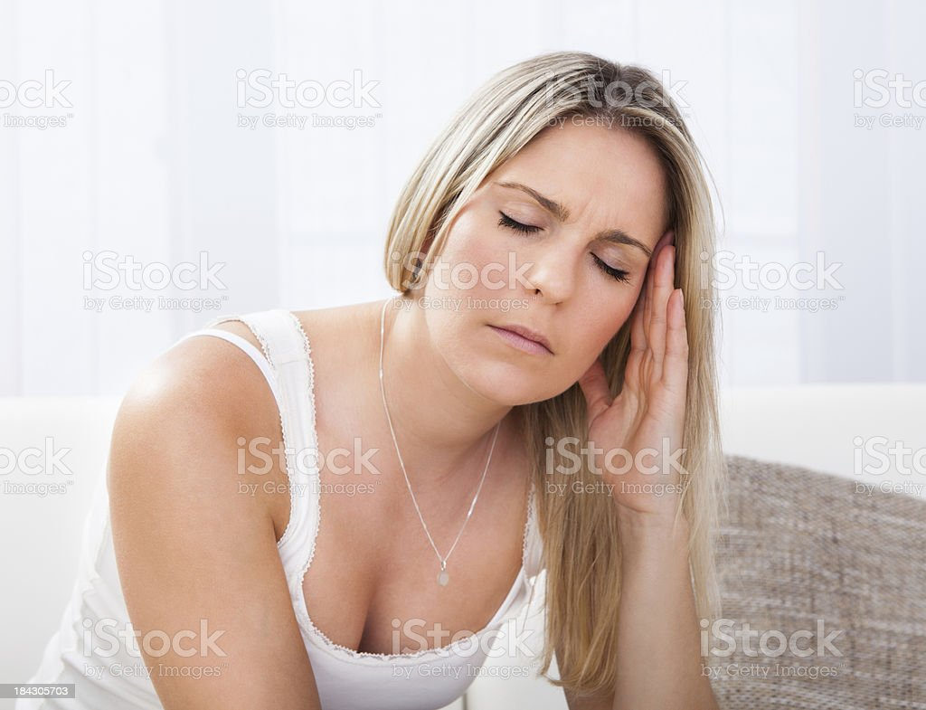 Portrait of woman with migraine stock photo