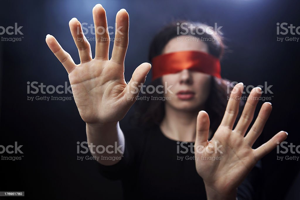 Portrait of woman with red bandage on eyes stock photo
