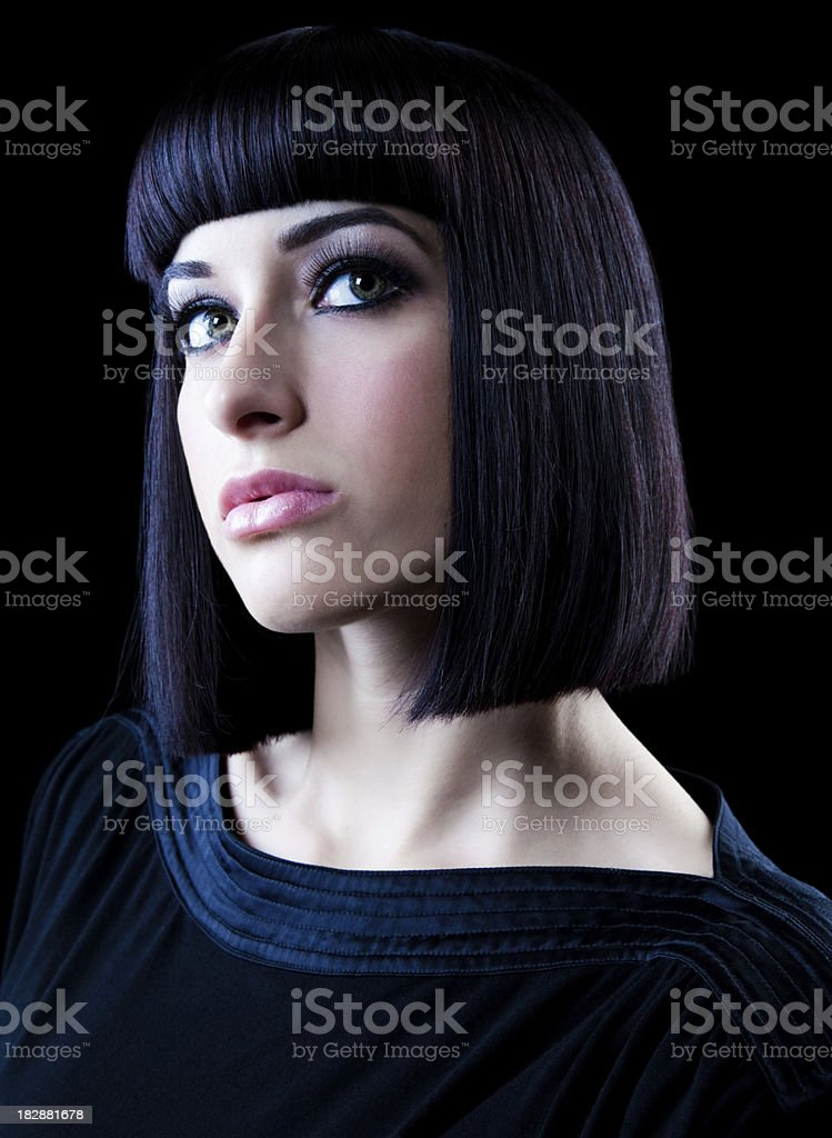 Portrait of Woman with Straight, Dark Hair. Black Background. royalty-free stock photo
