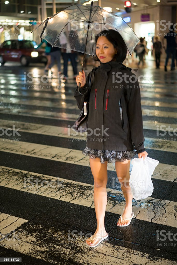 Portrait of  woman with umbrella on street in Kyoto, Japan. stock photo