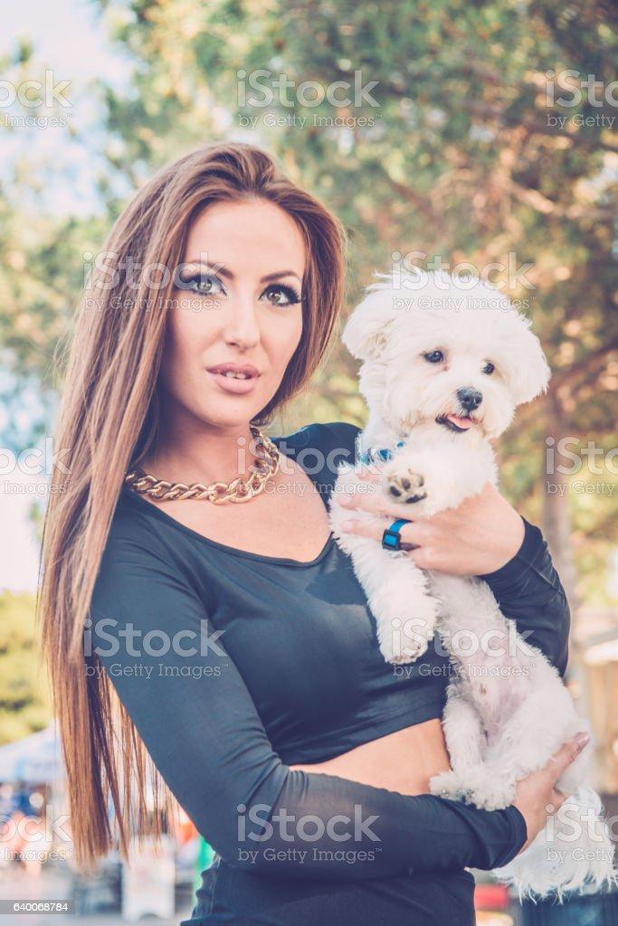 Portrait of Woman with White Small Dog, Portorose, Slovenia, Europe stock photo