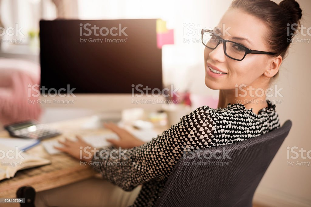 Portrait of woman working in her office stock photo