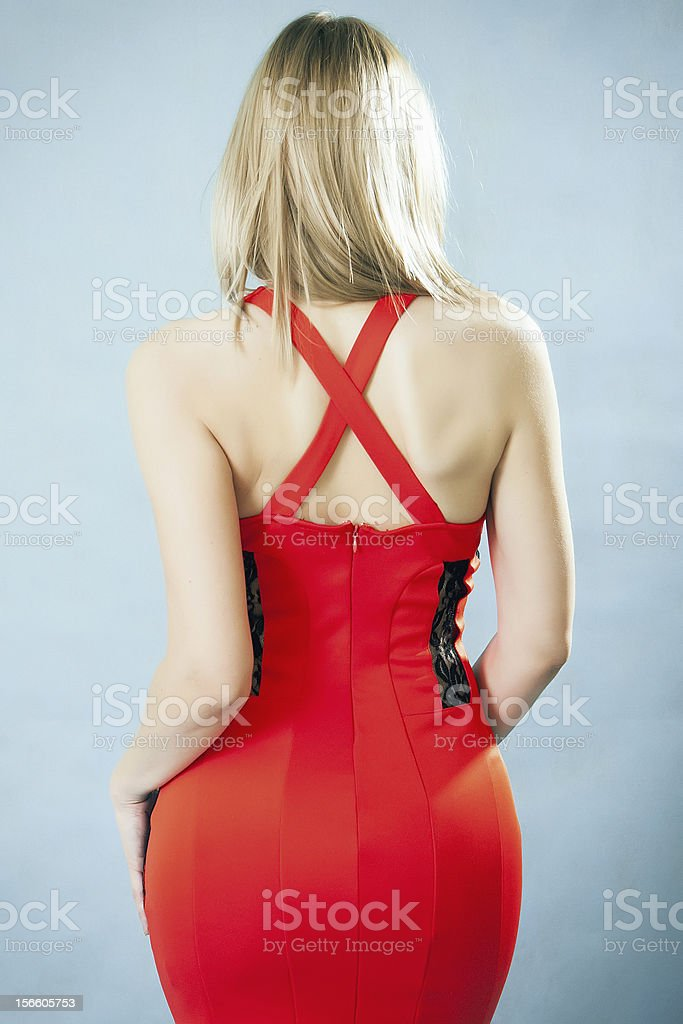 Portrait of woman's back with stylish red dress stock photo