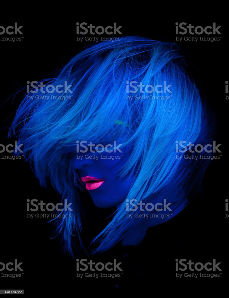 Portrait of women with red lipstick under ultraviolet light stock photo