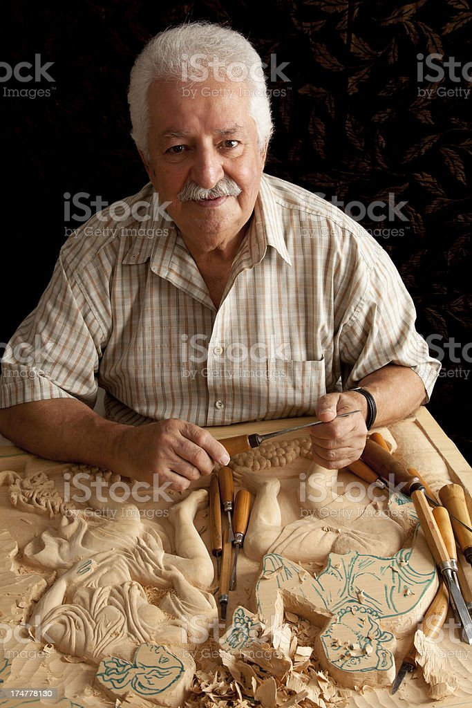 portrait of wood carving artist royalty-free stock photo