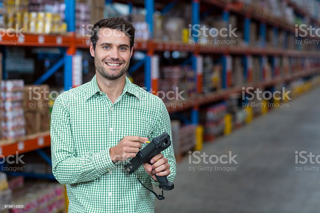 Portrait of worker using hand held computer stock photo