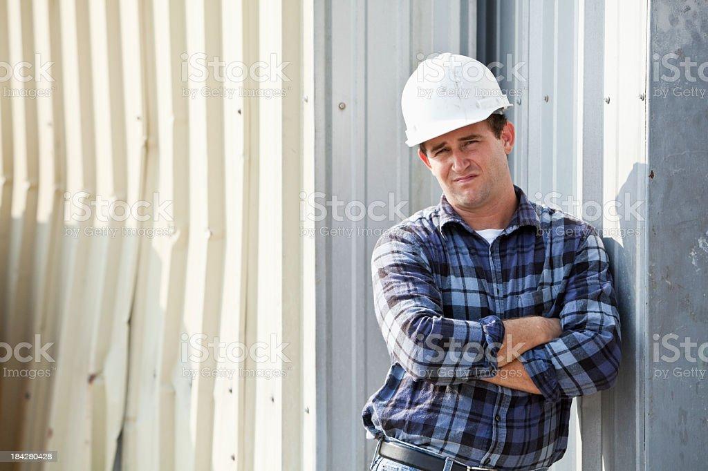 Portrait of worker wearing hard hat stock photo