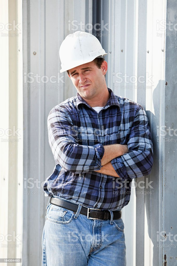 Portrait of worker wearing hard hat royalty-free stock photo