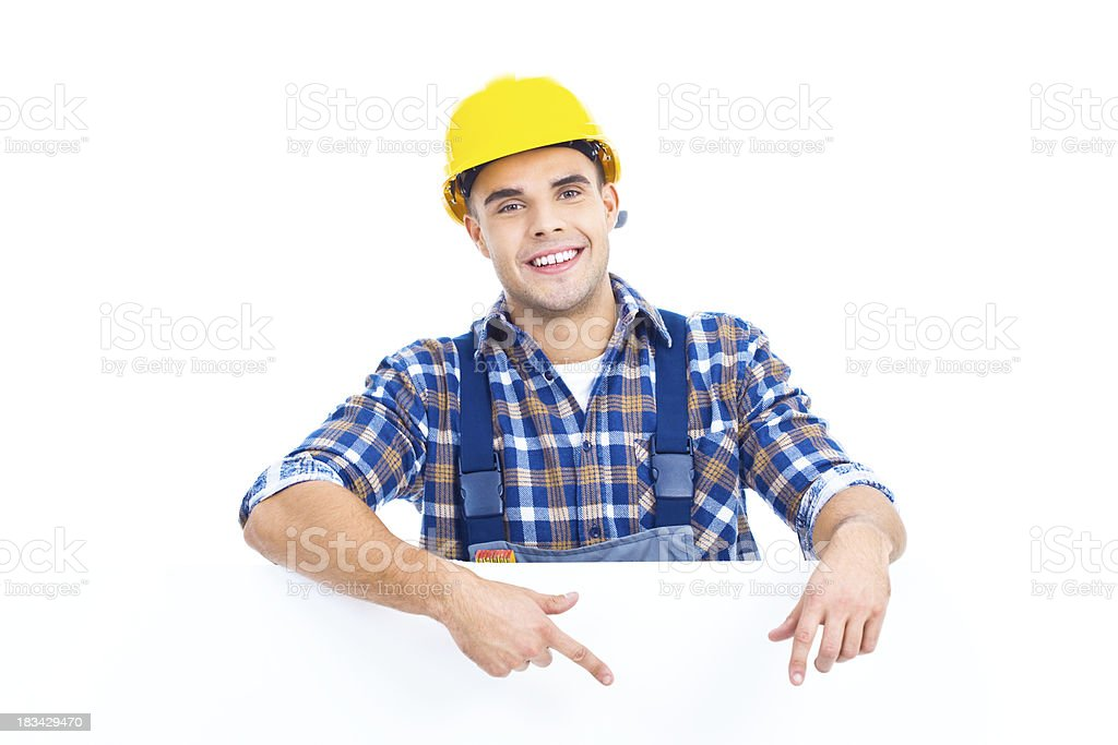 Portrait of worker with blank sign royalty-free stock photo