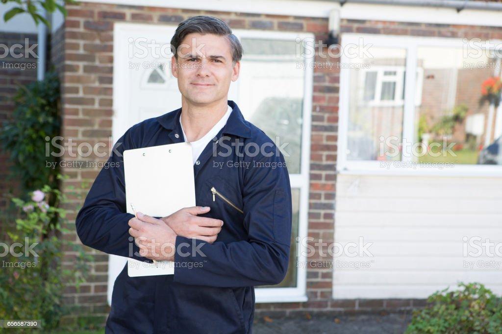 Portrait Of Workman Preparing Estimate For Work On House stock photo