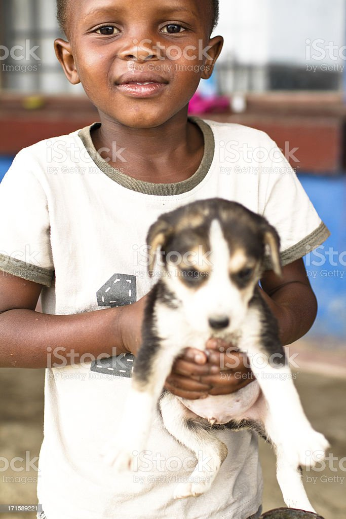 Portrait of Xhosa boy with a little puppy dog royalty-free stock photo