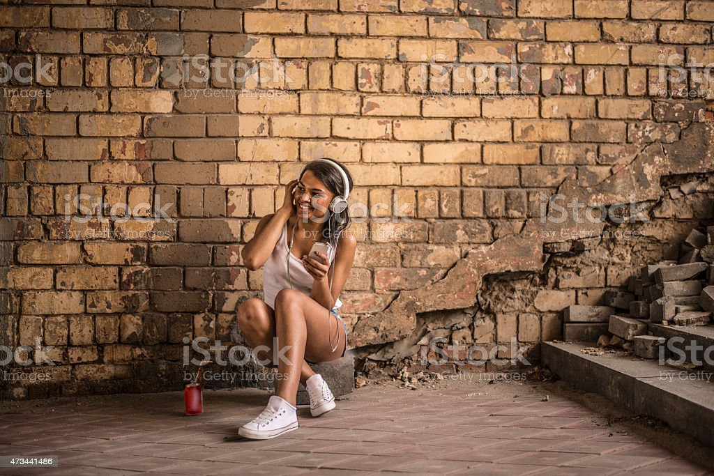 portrait of young adult attractive afro american woman listening stock photo