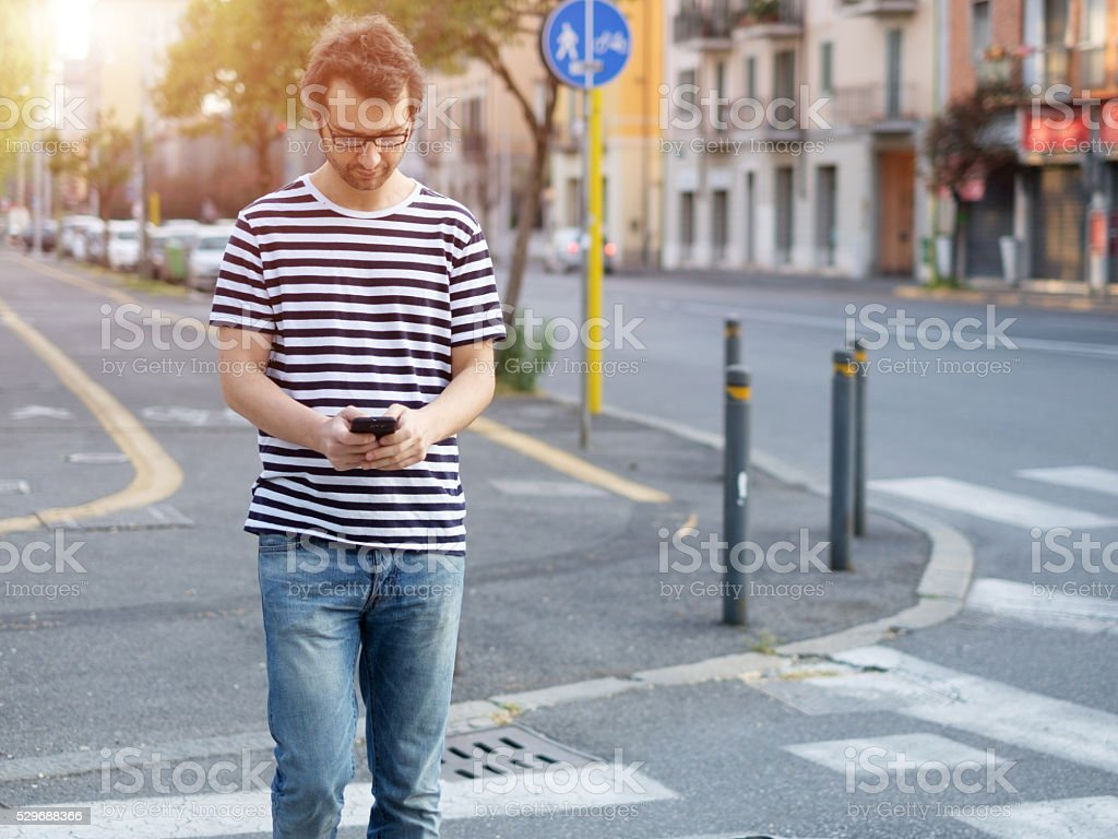 portrait of young adult man crossing stock photo