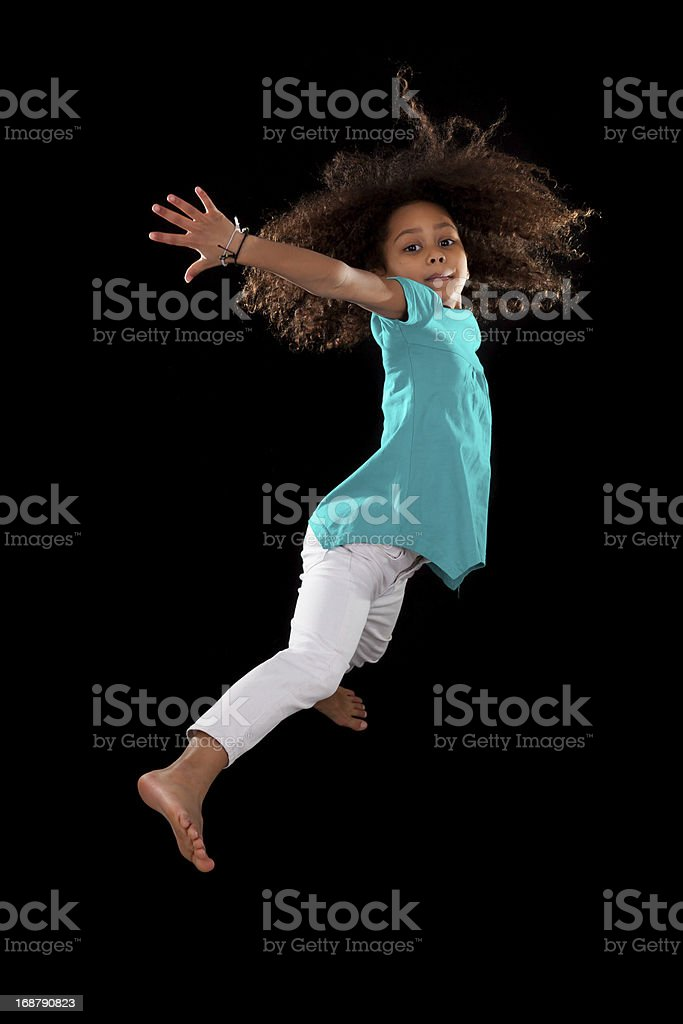 Portrait of Young African American girl jumping royalty-free stock photo