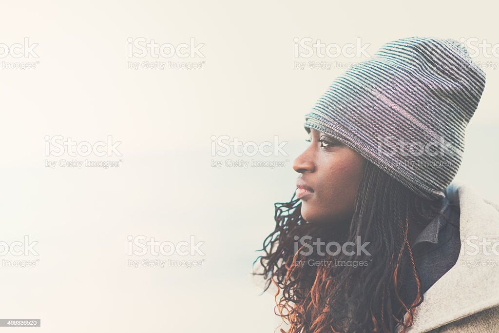 Portrait of young African woman in profile stock photo