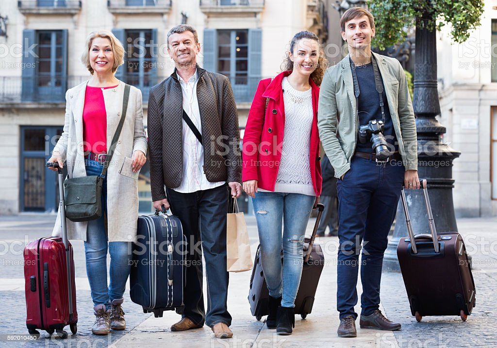 Portrait of young and mature couple with baggage stock photo