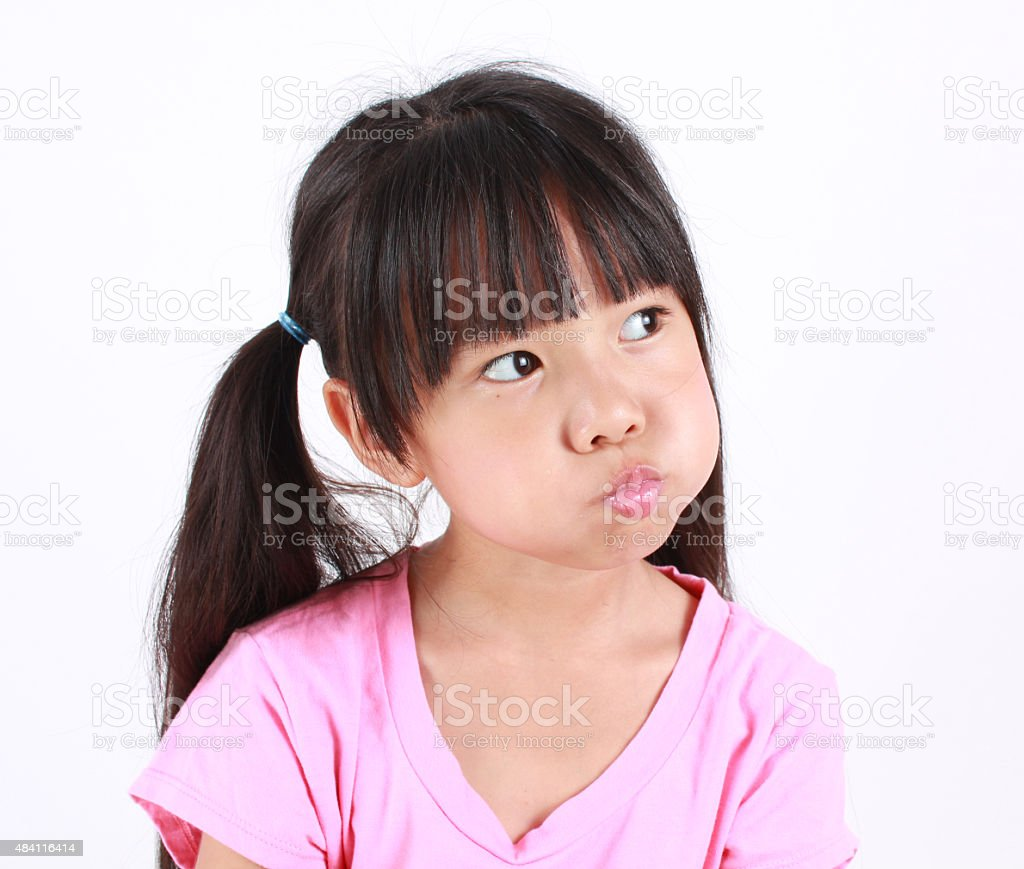 Portrait of young angry girl. stock photo