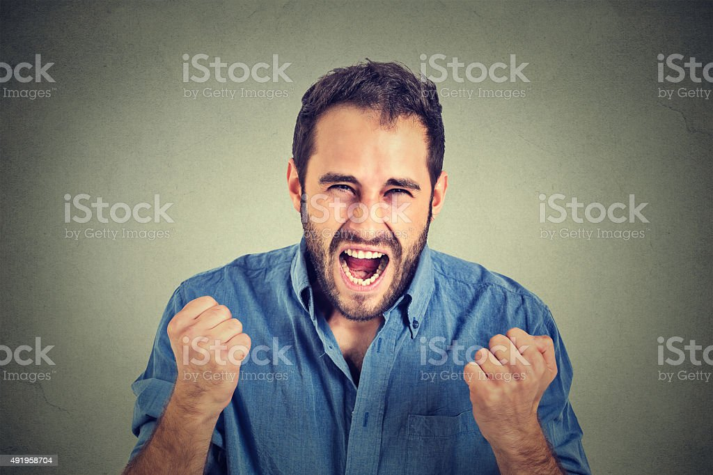 portrait of young angry man screaming stock photo