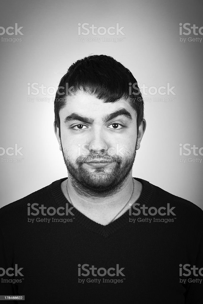 Portrait Of Young Arrogant Man Frowning stock photo