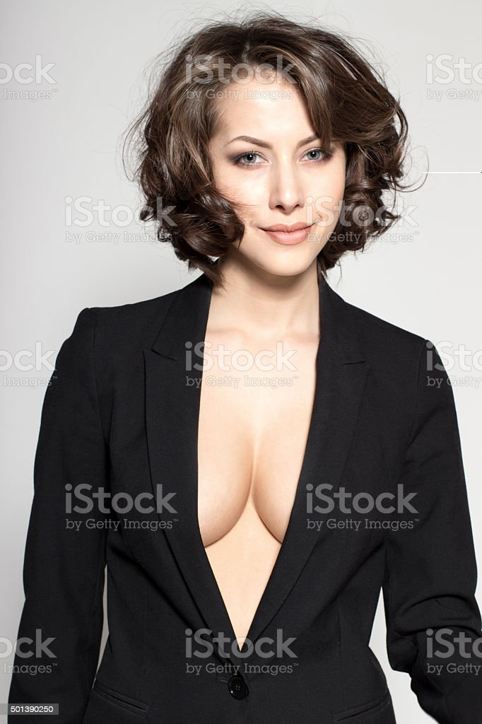 Portrait of young attractive sexy business woman or secretary stock photo
