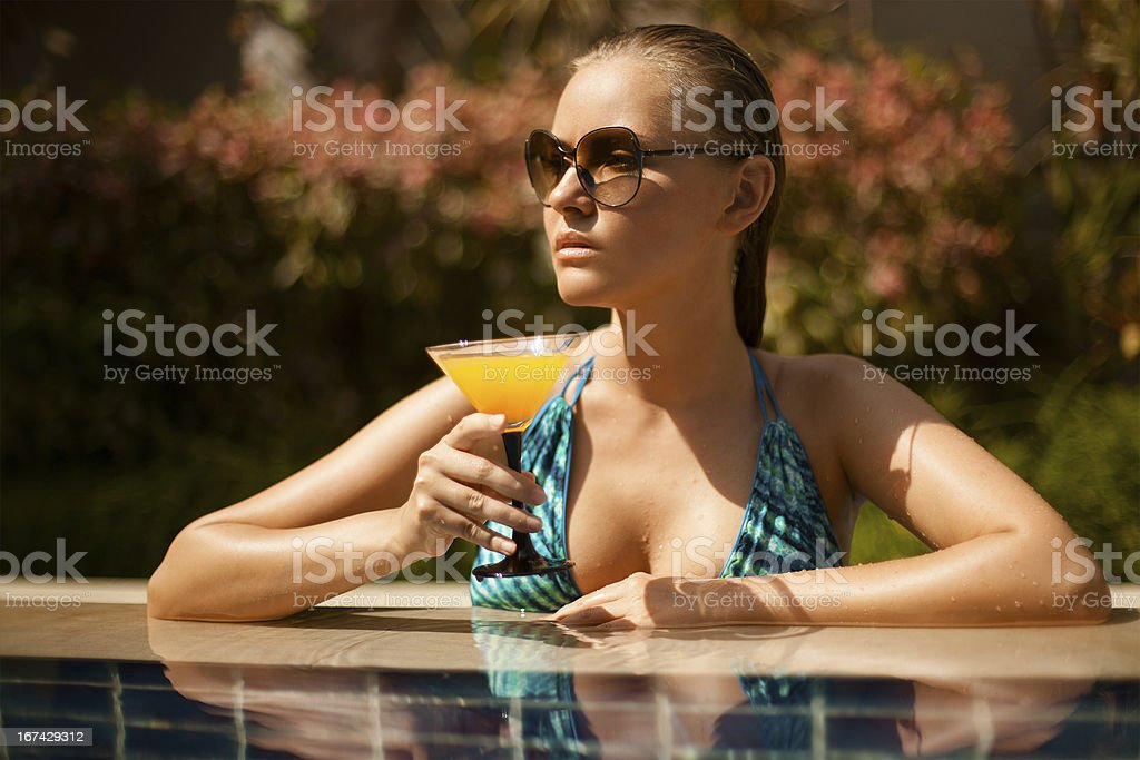 Portrait of young attractive woman having good time in swimming royalty-free stock photo