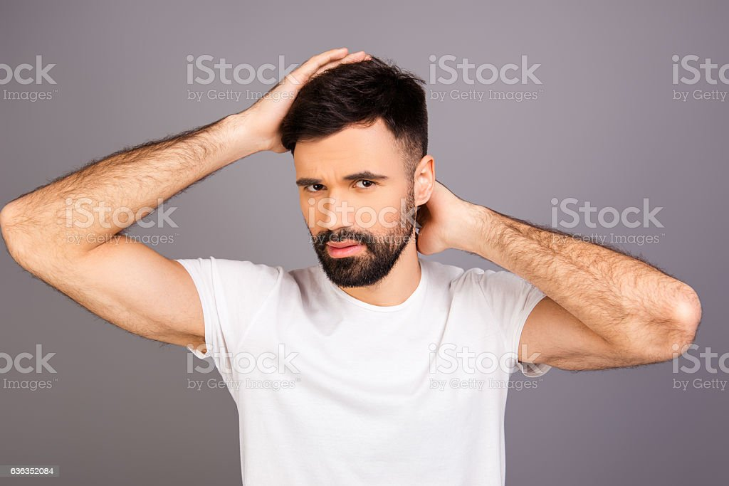 Portrait of young bearded man expertising his hair stock photo
