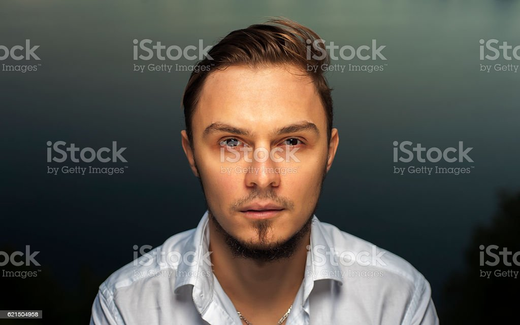 Portrait of young bearded man standing outdoors stock photo