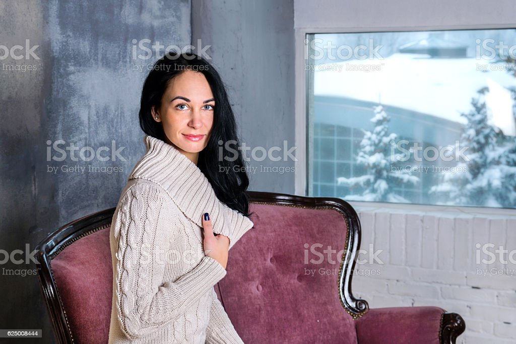 Portrait of young beautiful brunette woman on whinter background stock photo