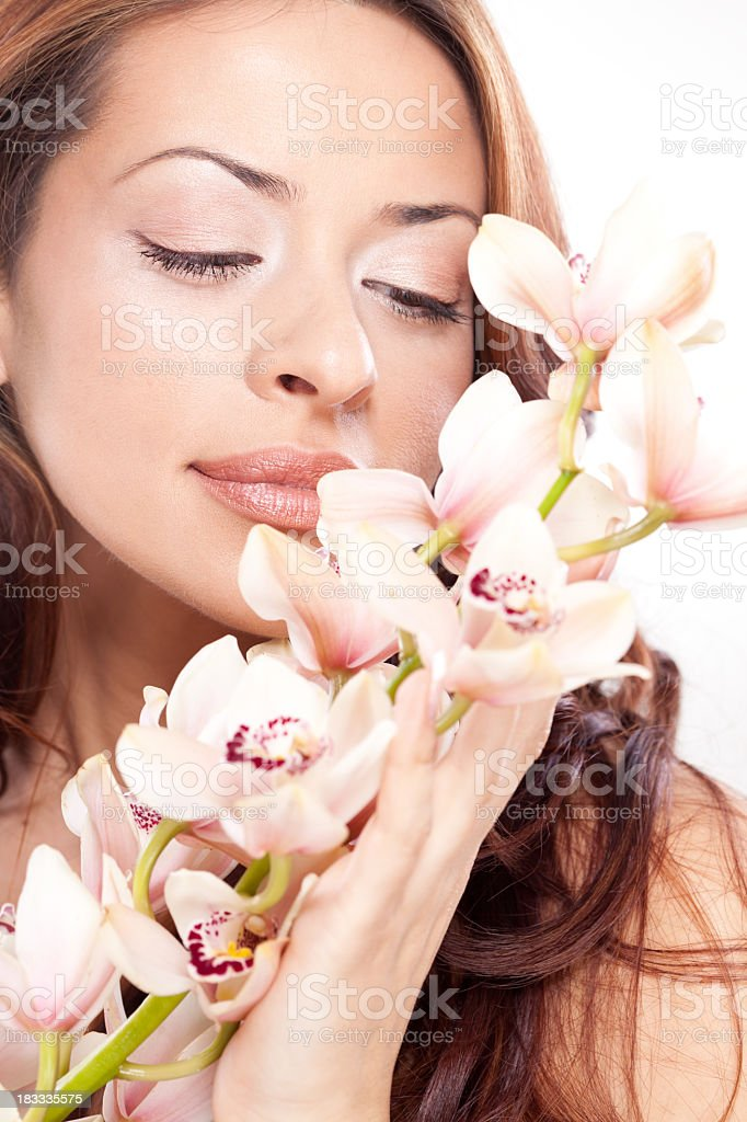 Portrait of young beautiful Caucasian woman with orchid royalty-free stock photo