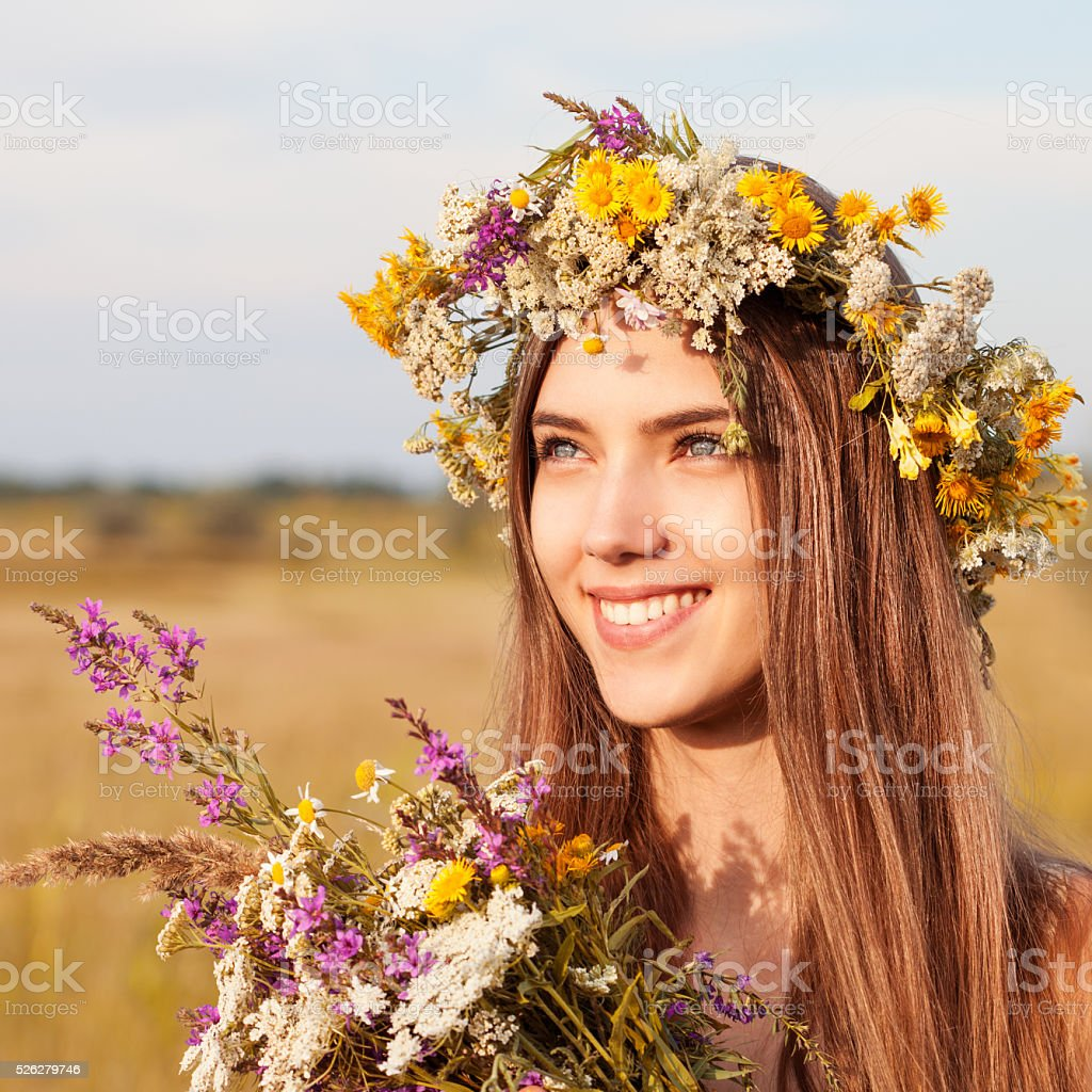 Portrait of young beautiful cute romantic  girl wearing a wreath stock photo