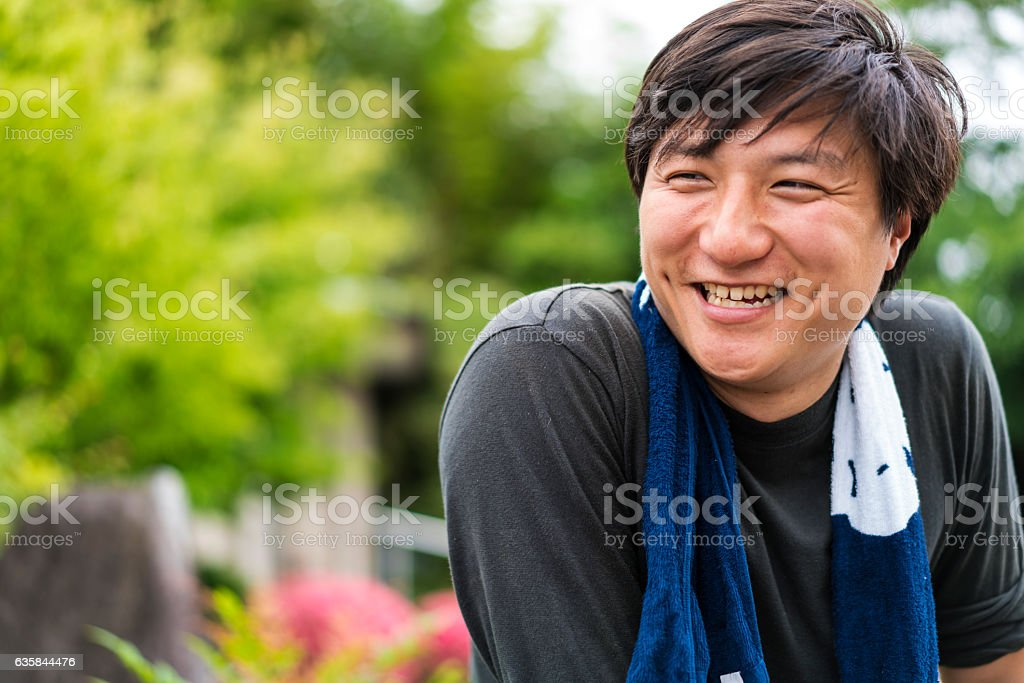 Portrait of young beautiful Japanese man in Park, Japan stock photo