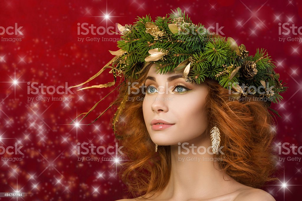 Portrait of young beautiful redhaired woman with firry wreath stock photo