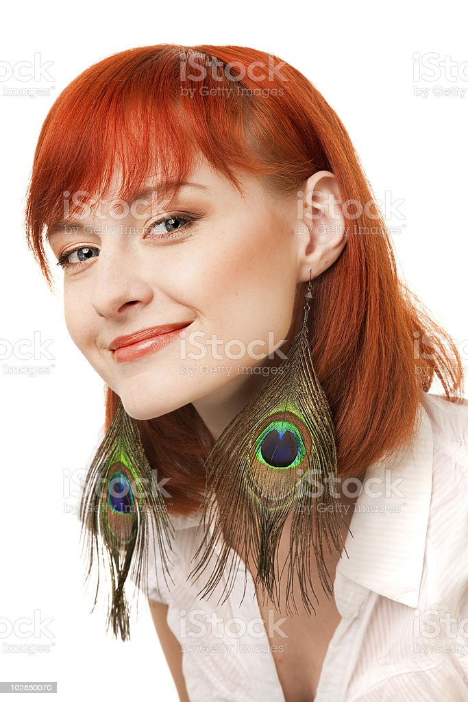 portrait of young beautiful redhead woman with peacock earrings royalty-free stock photo