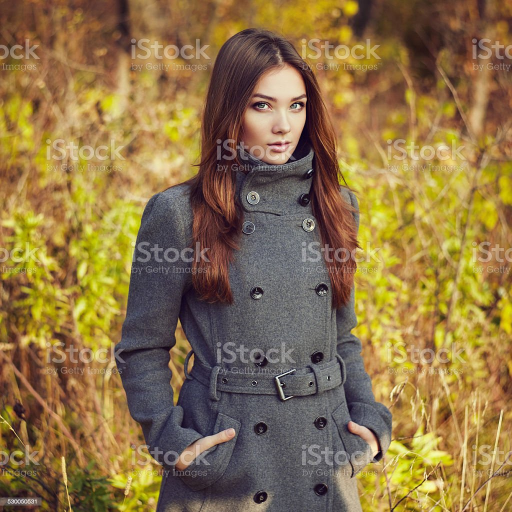 Portrait of young beautiful woman in autumn coat stock photo