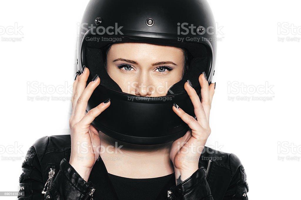portrait of young beautiful woman in biker helmet stock photo