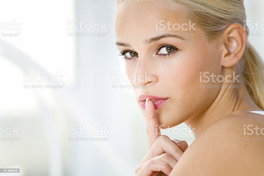 Portrait of young beautiful woman indoors royalty-free stock photo