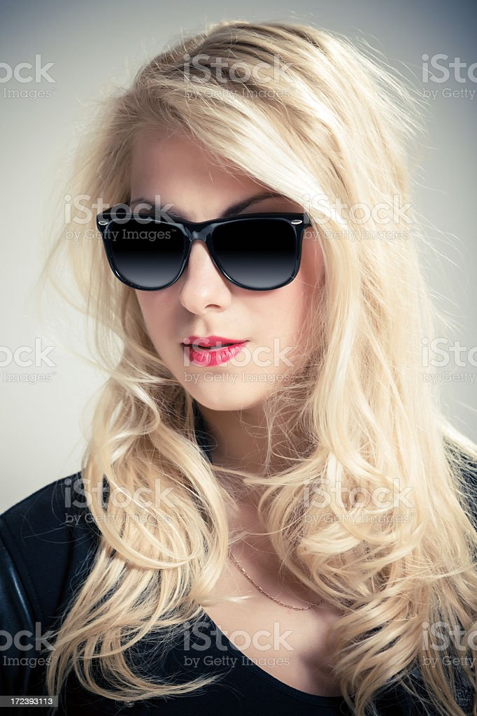 Portrait of young beautiful woman wearing sunglasses royalty-free stock photo
