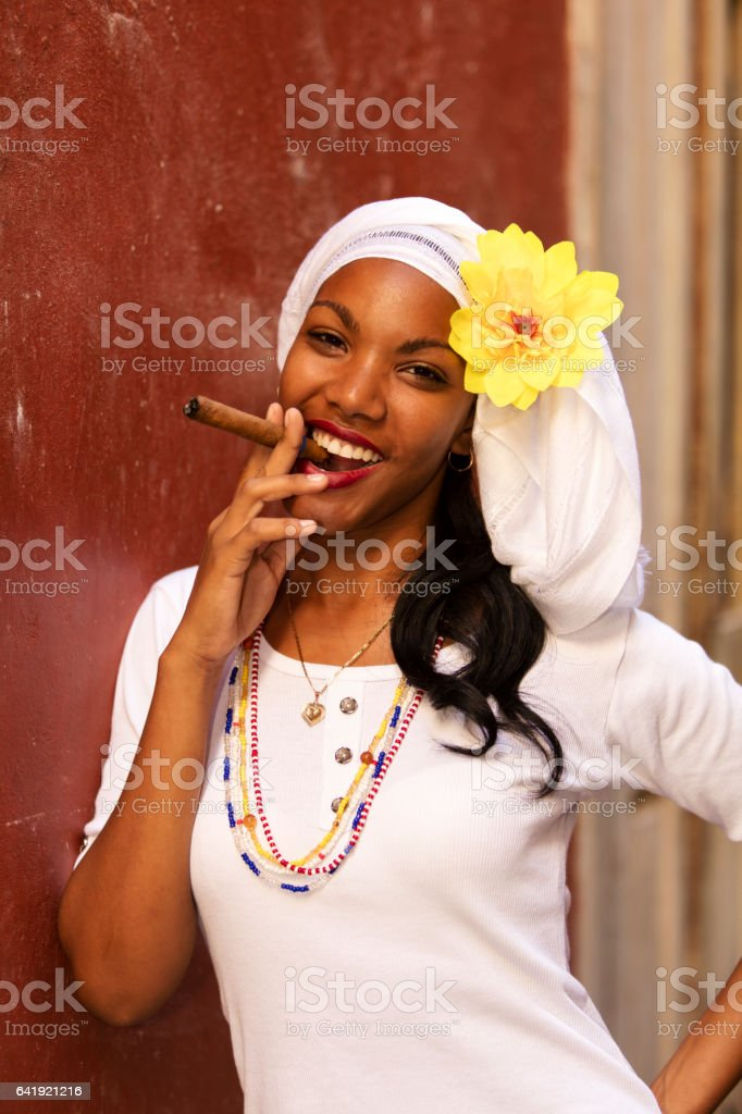 Portrait of Young Beautiful Woman With Cigar, Havana, Cuba stock photo