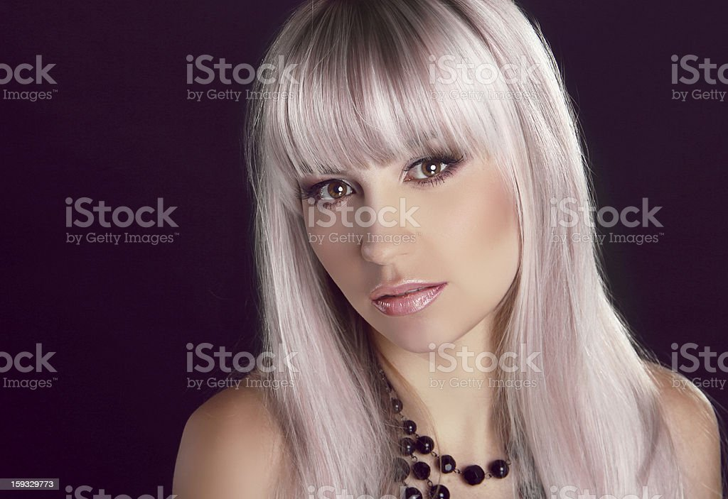 Portrait of young beautiful woman with colored glossy hair royalty-free stock photo