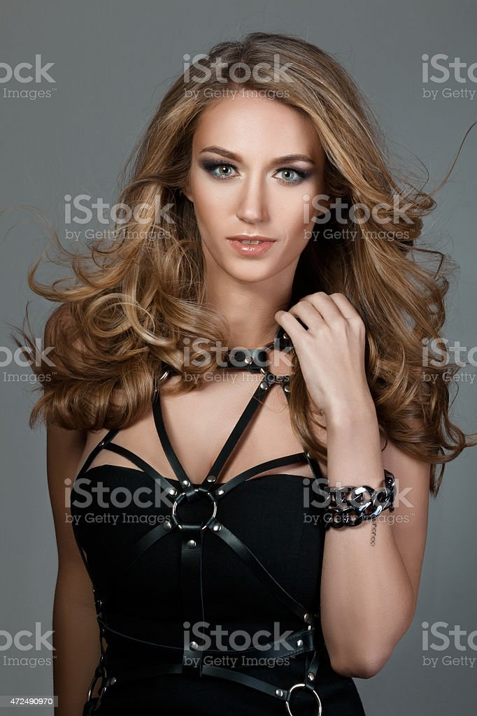 Portrait of young beautiful woman with flying-away hair stock photo