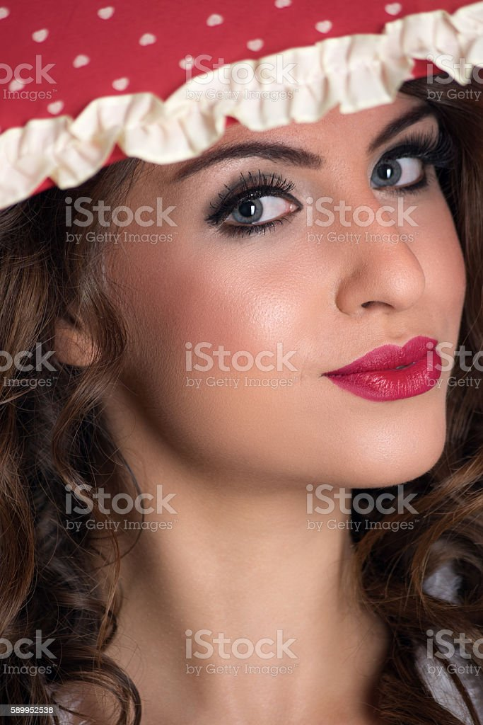 Portrait of young beauty woman under umbrella with red lipstick stock photo
