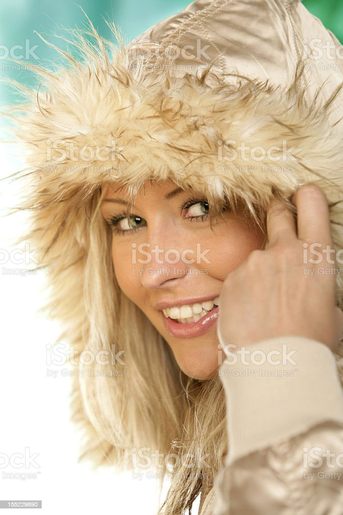 Portrait of young beauty woman wearing fur hood royalty-free stock photo