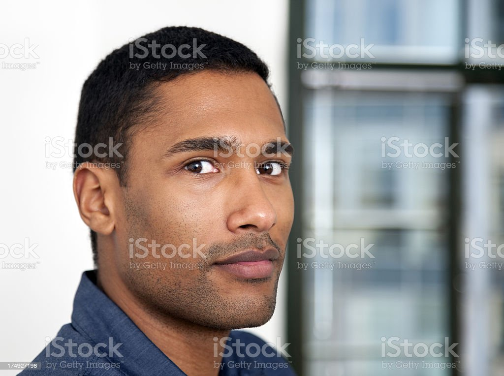 Portrait of Young Black Man Closre to Window Indoors royalty-free stock photo