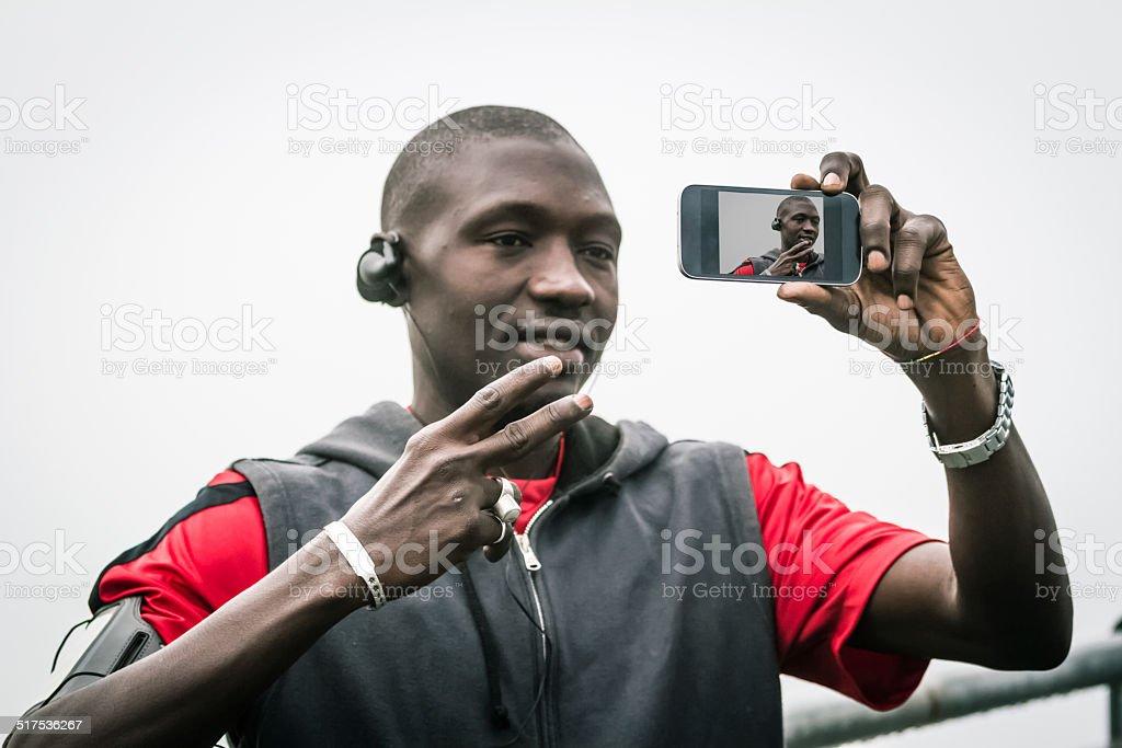 Portrait of Young black man doing selfie stock photo